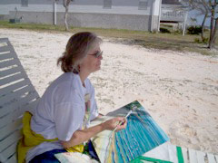 Pam Van Londen painting the bay at Navarre Beach, FL in 2006.